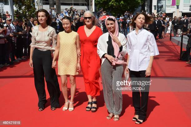 New Zealander director and President of the Feature films Jury Jane Campion poses with members of the Jury French actress Carole Bouquet South Korean...