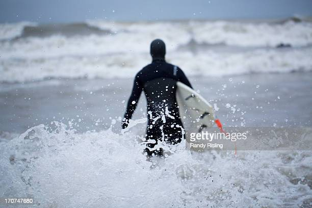 New Zealander Fremon Wolfe prepares to surf for the first time in the middle of winter in Lake Ontario after a fresh snowfall in Toronto About 10 cm...