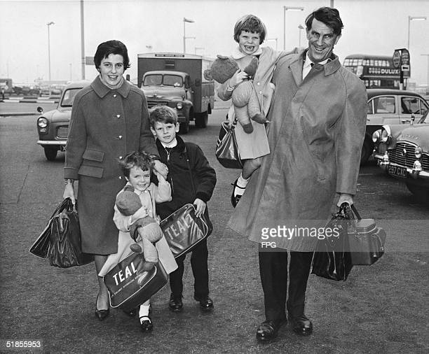 New Zealander mountain climber Sir Edmund Hillary walks with his family through the parking lot of an airport as they arrive to take a flight to...
