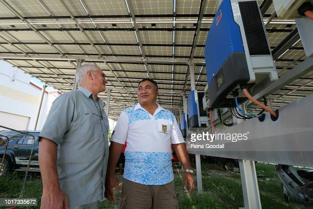 New Zealander Ted Wypych finance manager with Fatonga Talama general manager of the Tuvalu Electricity Company check the readouts on the solar energy...