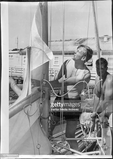 New Zealanders 18 footers on Sydney harbour for trialsForward hand Noel Heerdegen slips the sail of Miss Tip Top into the mast while skipper Ken...