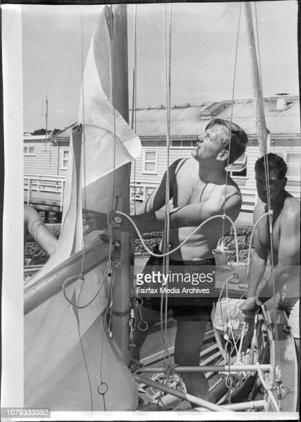 New Zealanders 18 footers on Sydney harbour for trials.Forward hand Noel Heerdegen slips the sail of Miss Tip Top into the mast while skipper Ken...