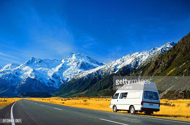 new zealand,mount cook national park,van in fore of mountains - white van stock photos and pictures