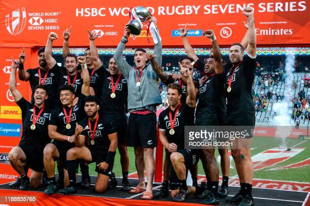 New Zealand's 7s rugby team celebrates on the podium after winning the World Rugby Sevens Series men's final rugby match between New Zealand and...
