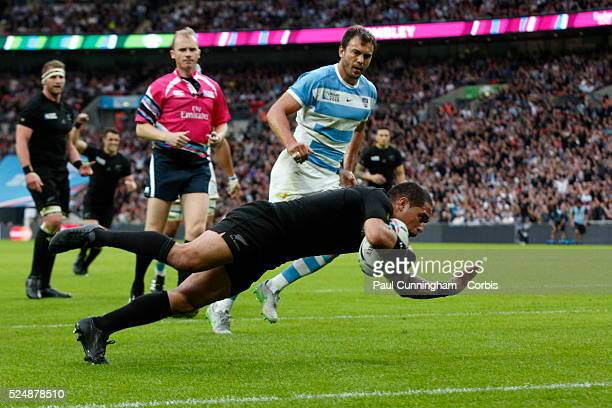 New Zealand's Aaron Smith darts over the line for a try giving the All Blacks the lead during the RWC 2015 match between New Zealand v Argentina at...