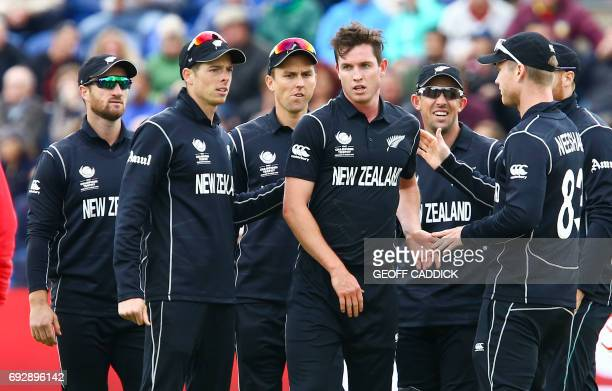 New Zealand's Adam Milne is congratulated by teammates after bowling out England's England's Alex Hales during the ICC Champions Trophy match between...
