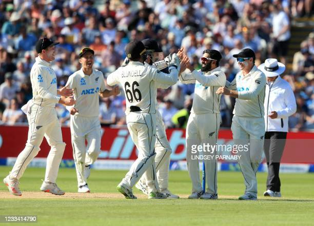New Zealand's Ajaz Patel celebrates after New Zealand's Tom Blundell caught England's Joe Root off his bowling on the third day of the second Test...