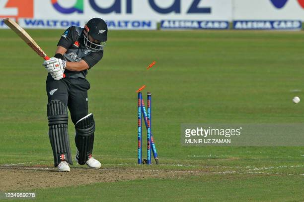 New Zealand's Ajaz Patel is bowled out during the first Twenty20 international cricket match between Bangladesh and New Zealand at the Sher-e-Bangla...