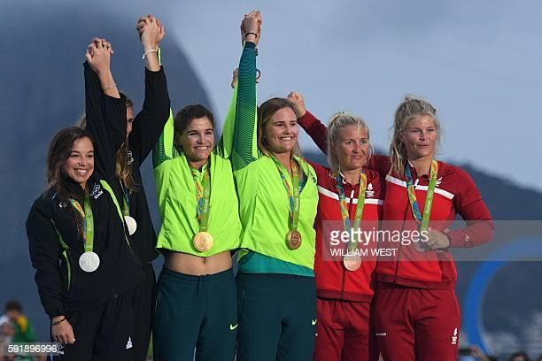 New Zealand's Alex Maloney and New Zealand's Molly Meech , Brazil's Marco Grael and Brazil's Kahena Kunze and Denmark's Jena Hansen and Denmark's...