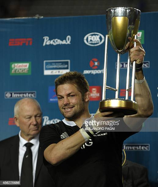 New Zealand's All Blacks' flanker Richie McCaw holds up the trophy after his team won the 2014 Rugby Championship at La Plata stadium in La Plata...