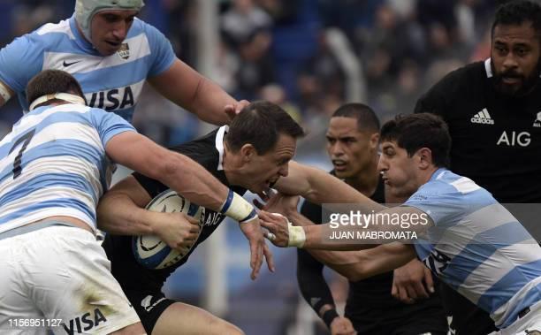 New Zealand's All Blacks fullback Ben Smith runs through a tackle by Argentina's Los Pumas flanker Marcos Kremer and lock Tomas Lavanini and...