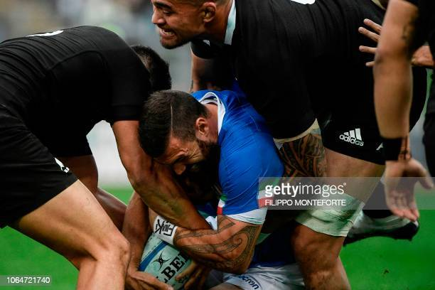 New Zealand's All Blacks inside centre Anton LienertBrown and New Zealand's All Blacks loose forward Vaea Fifita tackles Italy's back Jayden Hayward...