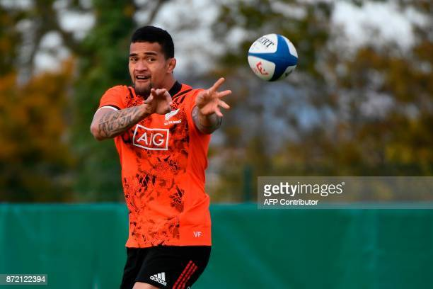 New Zealand's All Blacks loose forward Vaea Fifita passes the ball during a training session ahead of an upcoming test match against France on...