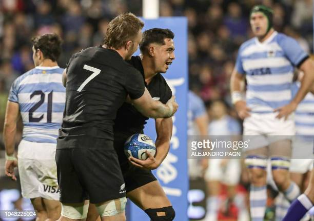 New Zealand's All Blacks players celebrate after centre Anton LienertBrown scoring a try against Argentina's Los Pumas during their Rugby...