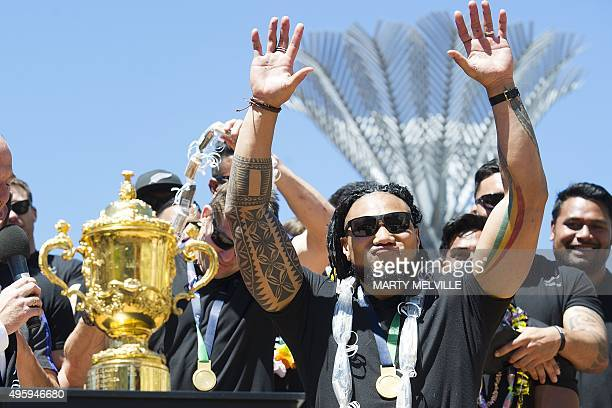 New Zealand's All Blacks rugby team player Ma'a Nonu waves to fans during a parade by the team through the central business district of Wellington on...
