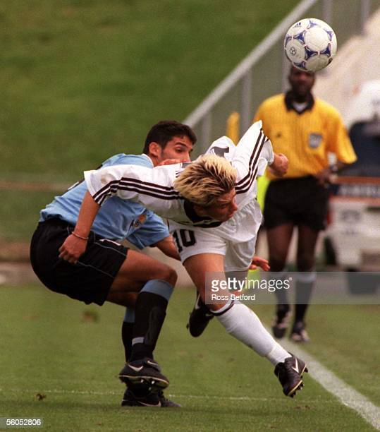 New Zealand's Allan Pearce attempts to keep the ball infield infront of Uruguay's Sebastin Alvarez in the FIFA under 17 World Championship at North...
