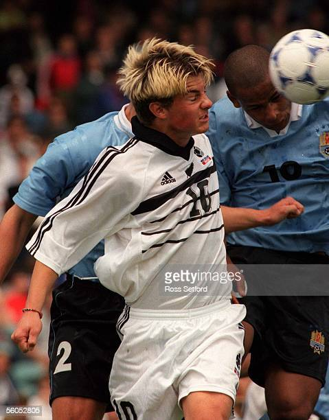 New Zealand's Allan Pearce heads the ball against Uruguay in the FIFA under 17 World Championship at North Harbour Stadium Albany Saturday Uruguay...