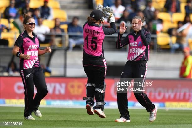 New Zealand's Amy Satterthwaite celebrates India's Priya Punia being caught with teammates Katey Martin and Amelia Kerr during the first Twenty20...