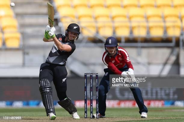New Zealand's Amy Satterthwaite plays a shot with England's wicket keeper Amy Jones during the third women's Twenty20 cricket match between New...