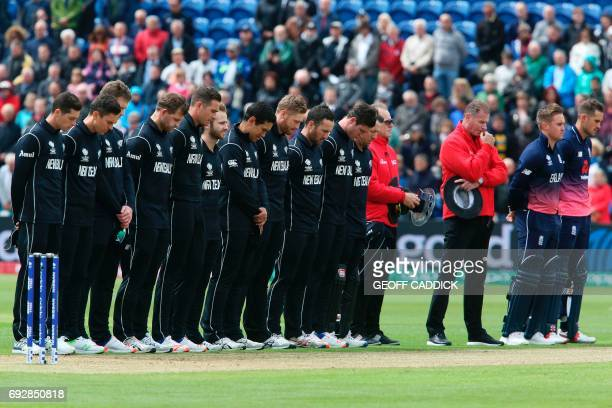 New Zealand's and England's players pause for a minutes' silence in memory of the victims of the June 3 London terror attacks during the ICC...