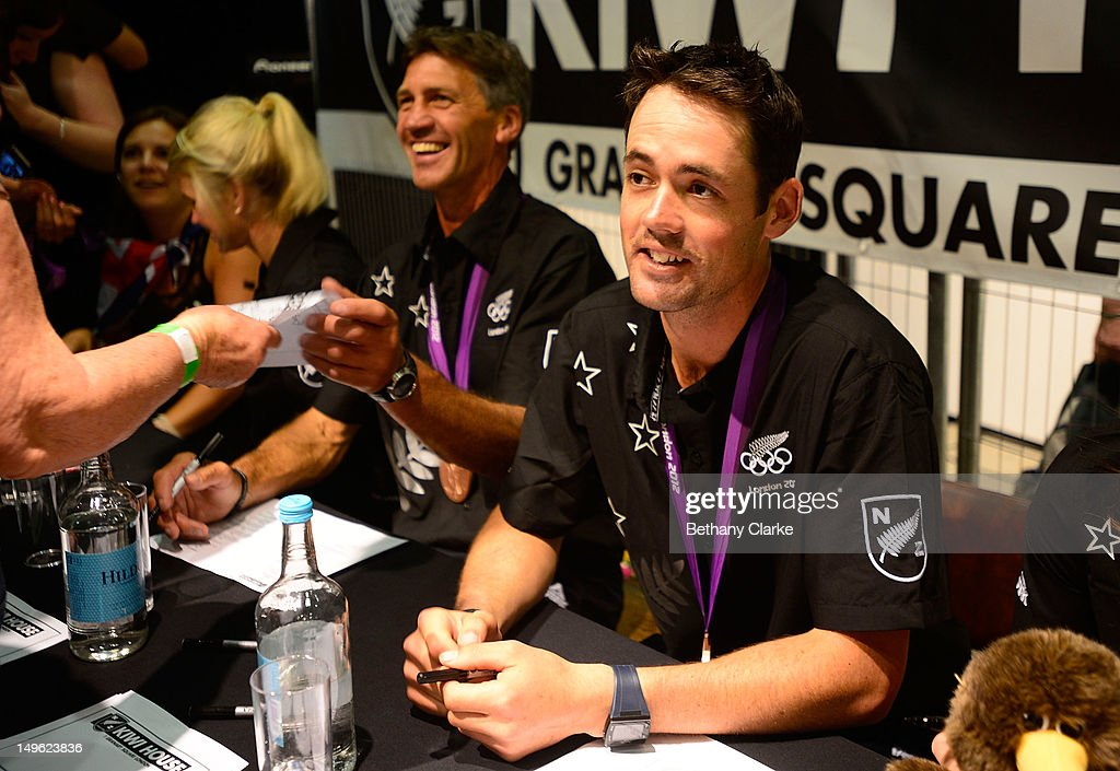 New Zealand's Andrew Nicholson and Jonathan Paget sign autographs for fans during a Visit Kiwi House on August 1, 2012 in London, England. New Zealand won their first medal at the London Olympics after they picked up bronze in the team's competition of the three-day eventing.