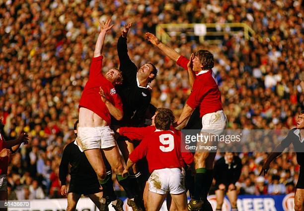 New Zealand's Andy Haden is flanked by Maurice Colclough and Steve Bainbridge of the British Lions as he competes for a restart during the fourth...