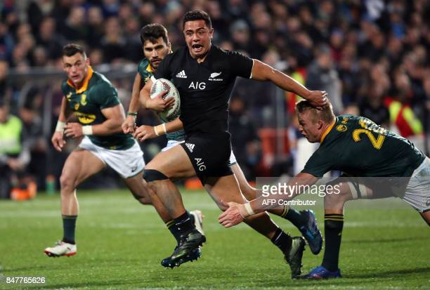 New Zealand's Anton LienertBrown avoids the tackle during the Rugby Championship match between New Zealand and South Africa at Albany Stadium in...