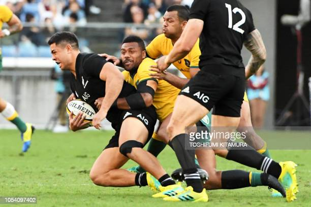 New Zealand's Anton LienertBrown is tackled by Australia's Samu Kerevi during the Bledisloe Cup rugby union Test match between the New Zealand All...