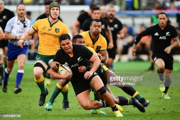 New Zealand's Anton LienertBrown is tackled during the Bledisloe Cup rugby union Test match between the New Zealand All Blacks and Australia at...