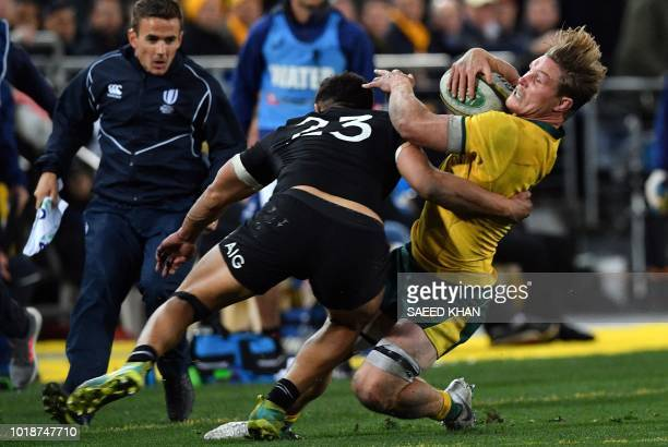 New Zealand's Anton LienertBrown tackles Australia's Michael Hooper during their Rugby Championship Bledisloe Cup match in Sydney on August 18 2018 /...