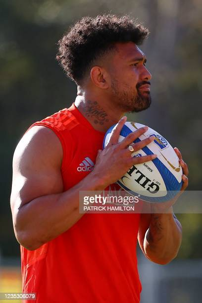 New Zealand's Ardie Savea throws the ball during the captain's run in Brisbane on September 17 ahead of Rugby Championship round four clash with...