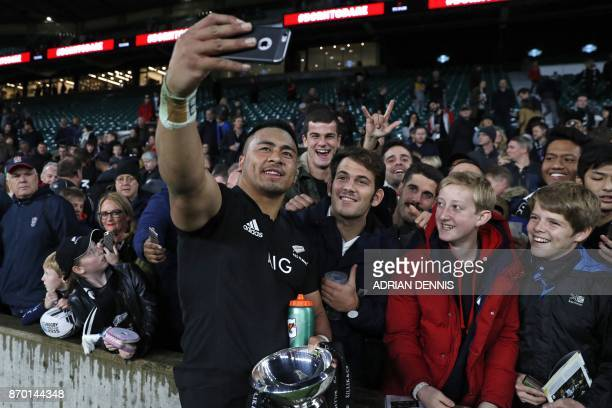 New Zealand's Asafo Aumua takes a selfie photograph with fans after the international rugby union match between Barbarians and New Zealand at...