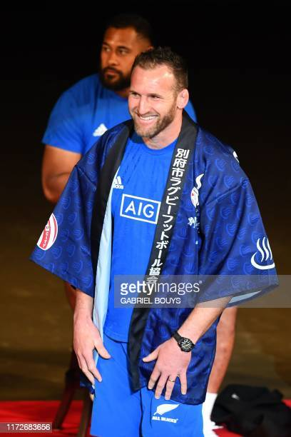 New Zealand's back row and captain Kieran Read wears a traditional Japanese happi coat at an All Blacks fan event in Beppu on October 1 during the...