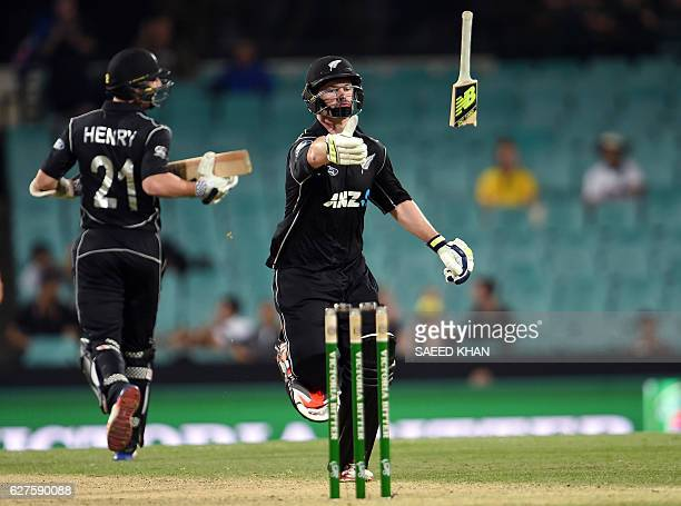 New Zealand's batsman Colin Munro throws his broken bat as he runs between the wickets during the first game of the One Day International Cricket...