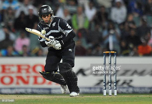 New Zealand's batsman Ross Taylor looks at a ball from Pakistan's bowler Mohammad Aamir during ICC Champions Trophy 2nd semi final between Pakistan...