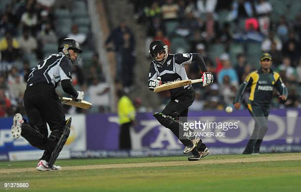 New Zealand's batsmen Ross Taylor and teammate Aaron Redmond vie with a ball from Pakistan's bowler Mohammad Aamir during the ICC Champions Trophy...