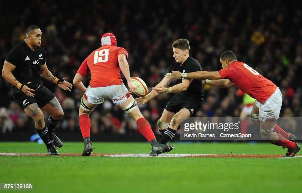 New Zealand's Beauden Barrett offloads before being tackled by Wales' Taulupe Faletau during the 2017 Under Armour Series Autumn International match...