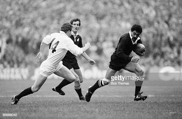 New Zealand's Bernie Fraser who scored two tries races past Scotland's Jim Pollock who scored the vital lastminute try to even the score during the...