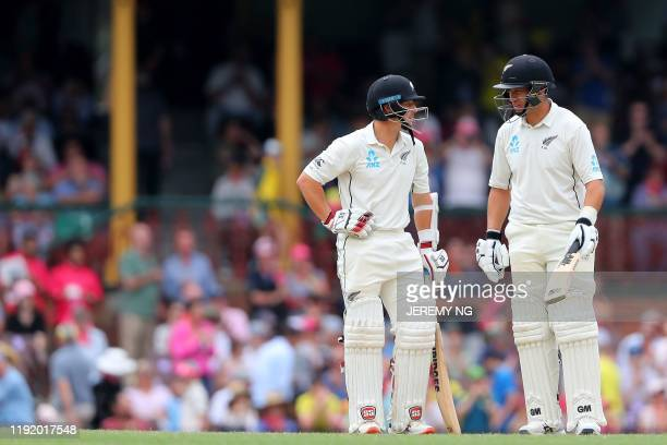 New Zealand's BJ Watling and Ross Taylor speak during the fourth day of the third cricket Test match between Australia and New Zealand at the Sydney...