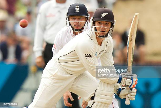 New Zealand's BJ Watling bats with England's Ian Bell looking on during day three of the 2nd international cricket Test match between New Zealand and...