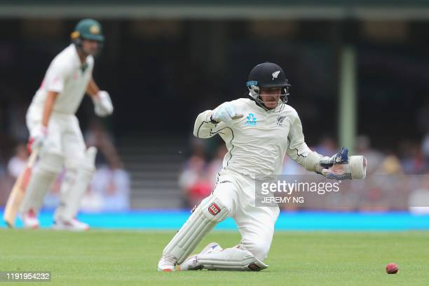 New Zealand's BJ Watling fields the ball during the fourth day of the third cricket Test match between Australia and New Zealand at the Sydney...
