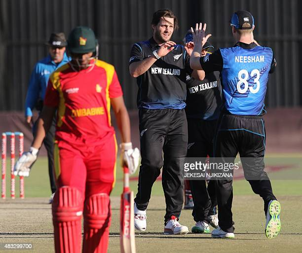 New Zealand's bowler Mitchell McGlenaghan celebrates a wicket with teammates during the third and final game in a series of three oneday...