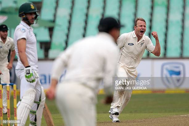 New Zealand's bowler Neil Wagner celebrates the dismissal of South Africa's batsman Faf Du Plessis during the first cricket test match between South...