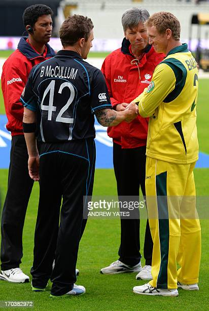 New Zealand's Brendon McCullum and Australia's George Bailey shake hands with the umpires on the pitch during an inspection for a rain delay at the...