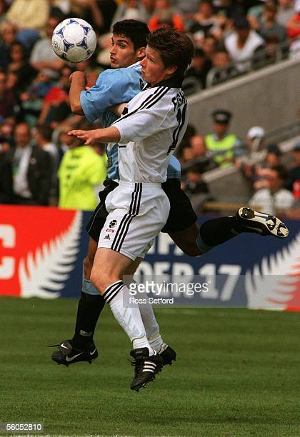 New Zealand's Brent Fisher contests the ball with Uruguay's Javier Garcia in the FIFA under 17 World Championship at North Harbour Stadium Albany...