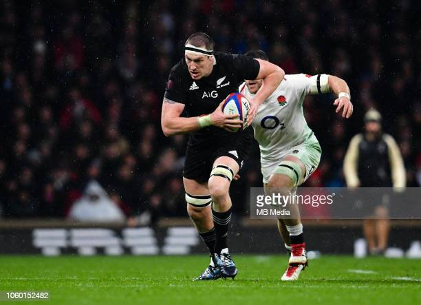 New Zealand's Brodie Retallick evades the tackle of England's Mark Wilson during the Quilter International match between England and New Zealand at...