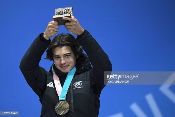 New Zealand's bronze medallist Nico Porteous poses on the podium during the medal ceremony for the freestyle skiing men's halfpipe at the Pyeongchang...
