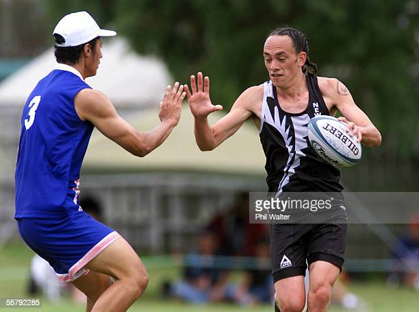 New Zealand's Bruce Kake about to be touched by Samoa's Ben Collins in their Mens U21 match in the Youth Touch World Cup played at Lloyd Elsmore Park...