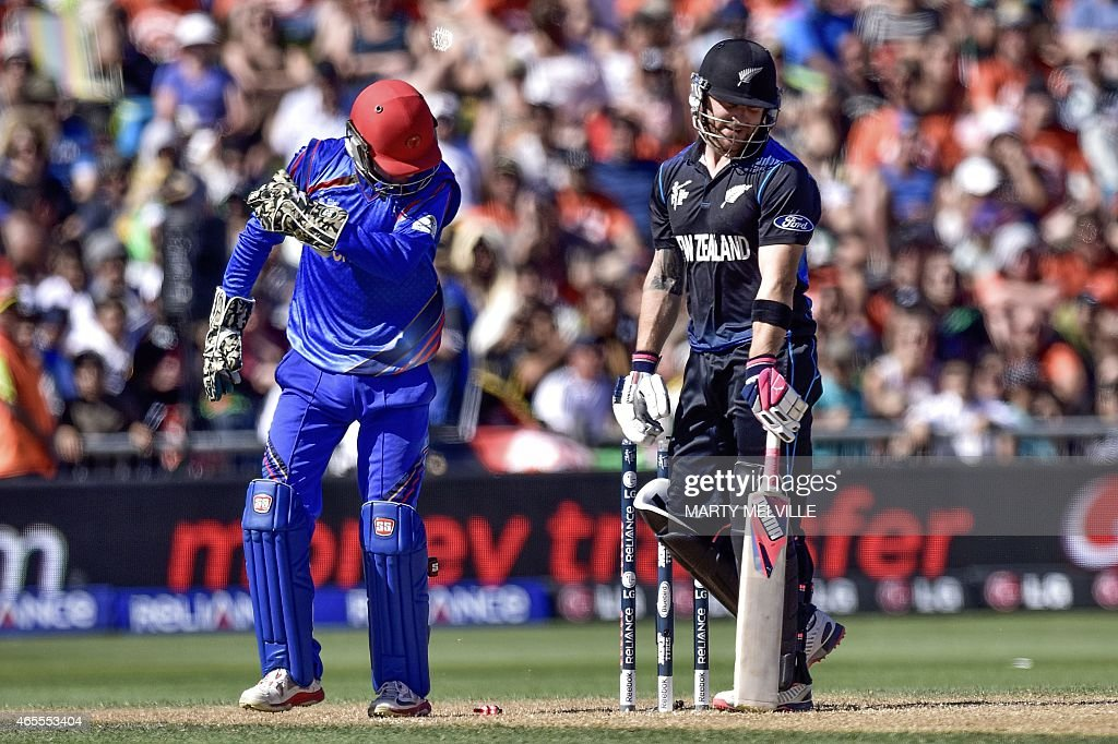 New Zealand's captain Brendon McCullum (R) reacts to being bowled by Afghanistan's captain Mohammad Nabi during the Pool A 2015 Cricket World Cup cricket match between New Zealand and Afghanistan at McLean Park in Napier on March 8, 2015.