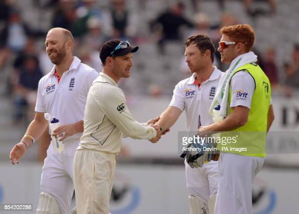 New Zealand's captain Brendon McCullum shakes hands with England's Ian Bell as the match is drawn during Day Five of the First Test at the University...